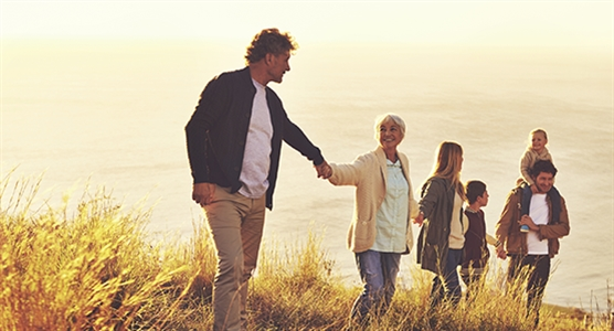 Image of a family on a walk on the Funeral Protection Plus page.